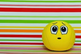 yellow ball with apologetic face