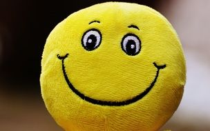 yellow ball with a good smile