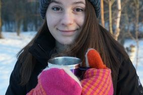 happy Teen Girl with Cup of hot drink outdoor at Winter