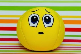 ball with an apologetic smiley