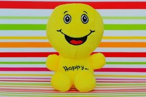 "soft smiley with the words ""happy"""