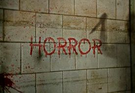 Horror, red lettering in tiled wall