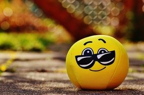 soft yellow smiley with glasses