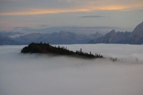 gorgeous landscape with Mountains at sky above Fog
