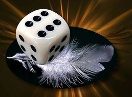 dice and white feather