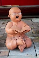 funny Buddha with glasses Stone Figure