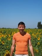 Man in filed sunflowers