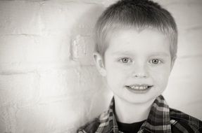 black and white picture of a cute young boy