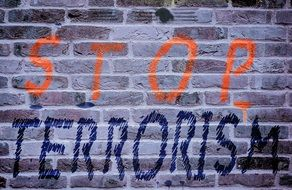 inscription stop terrorism on the wall
