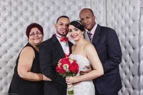 newlyweds with parents romance photo