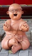 laugh Buddha with glasses Stone sculpture