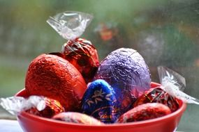 multicolored easter chocolate eggs in foil