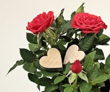 wooden hearts on the roses bouquet