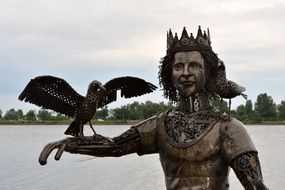 fantasy king with bird on hand, metal sculpture at Sea