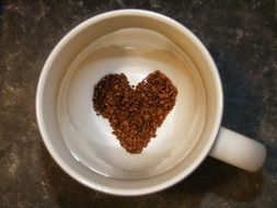 heart on a froth in a cup of coffee