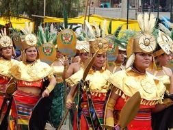 girls in golden carnival costumes