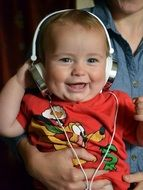 Toddler with headphones young music lover