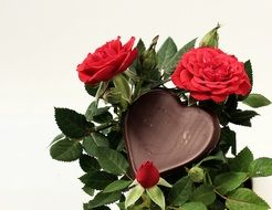 chokolate heart in the roses bouquet