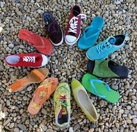 multi-colored shoes stand in a circle