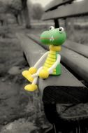 toy crocodile on the bench