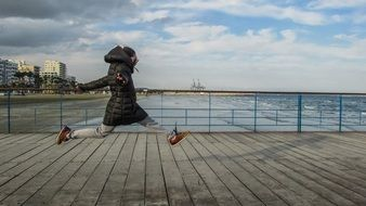 girl jumping for joy on the bridge