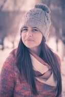 girl with long hair in winter hat