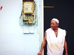 hardworking person at the exit of a building in Cuba