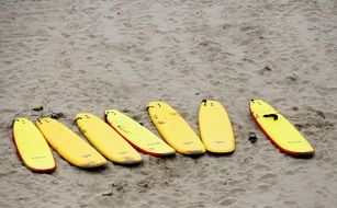 Yellow Surf Boards on a beach