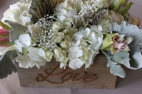 bunch of flowers in vintage box with writing love