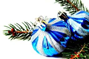 blue Christmas baubles and fir tree branch