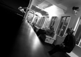 black and white photo of the interior of a commuter train