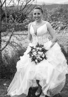 black and white photo of a happy bride among nature