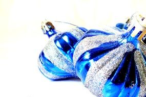 blue Christmas baubles on the white background