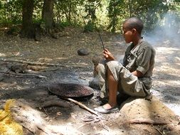 African child near the fire
