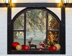 window with christmas attributes