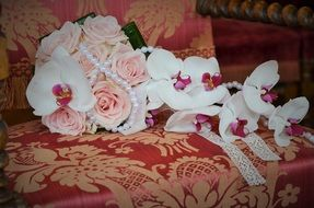 wedding bouquet with roses and orchids