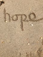 inscription hope on the sand