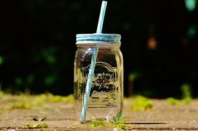 jar with a straw for a summer drink