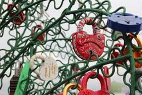 love locks on a wrought fence