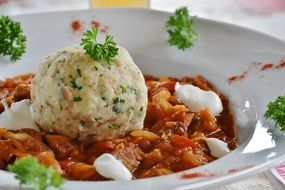 Goulash Dumpling meal on white plate