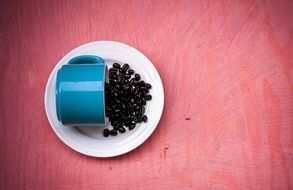 coffee beans on a blue cup background