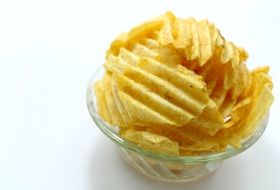 potato curly chips in a transparent plate