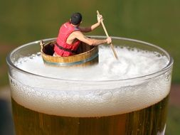 figure of a man floating in a beer glass