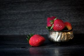 red Delicious Strawberries in bowl closeup