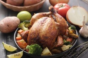 roasted chicken with spices and vegetables