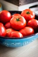 ripe tomatoes in a bowl