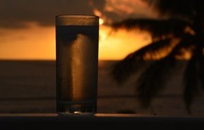 Glass of cold soda at the sunset