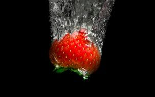 Red healthy sweet strawberry in the water