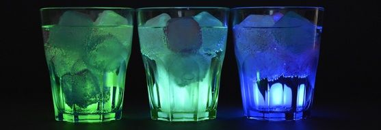 banner with illuminated glasses with ice cubes