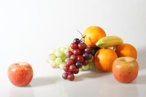 Pictures still life of fruit bananas, apples, grapes and oranges